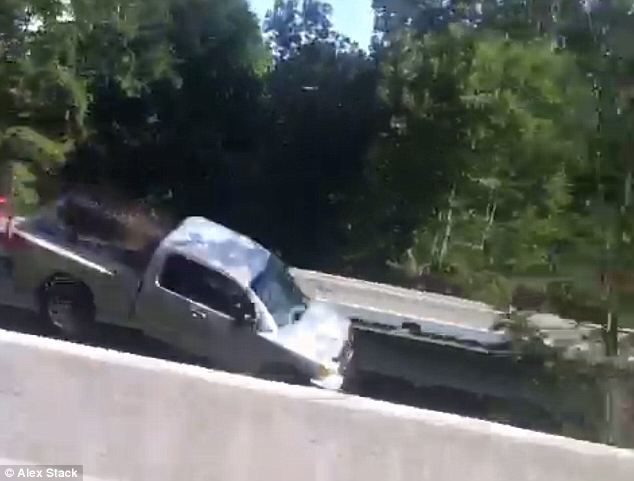 Out of control: The speeding truck very nearly cleared the gap. It remained unclear Tuesday what caused the 59-year-old male driver to lose control