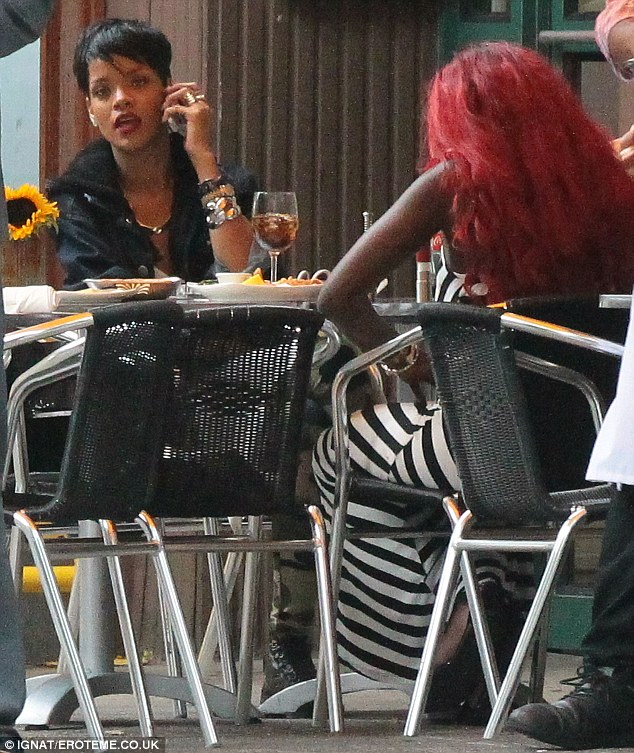 Lunch and the city: Rihanna and a red-headed friend catch up over a bite to eat