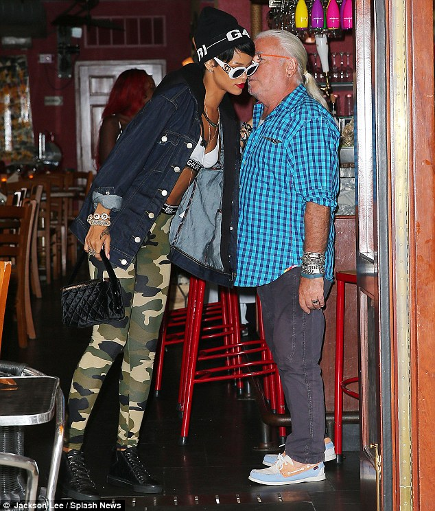 Recognised wherever she goes: Rihanna chats to a fan from the older generation