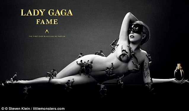 Lady Gaga poses naked in the ad campaign for her perfume, Fame. The singer has miniature scantily-clad men crawling over her body to save her blushes