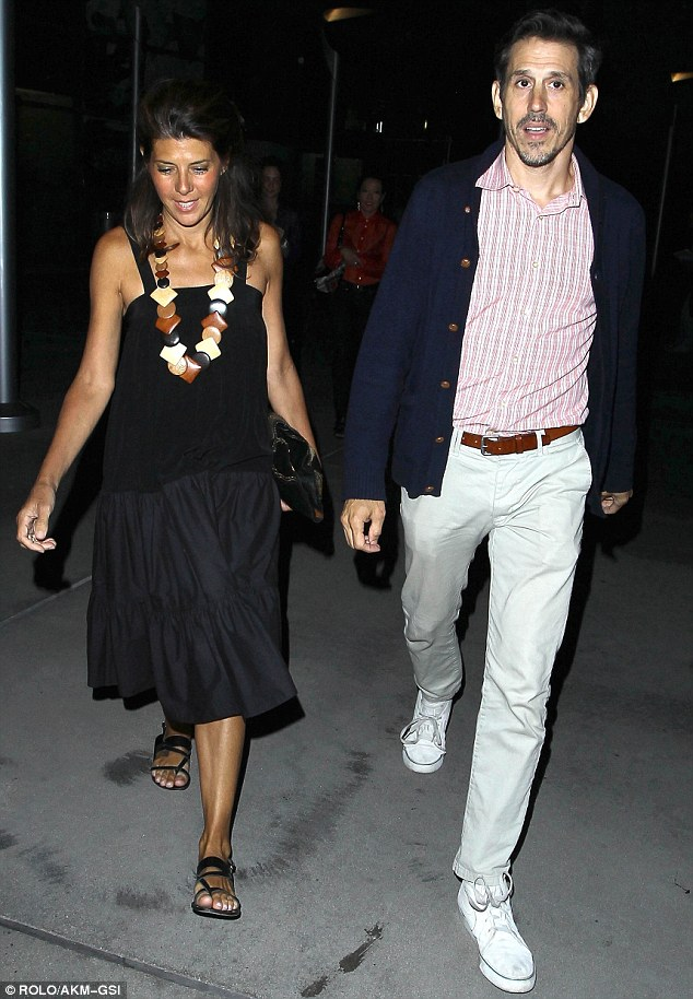 Calm before the giggle storm: Marisa was super composed as she arrived at the screening with her brother Adam by her side