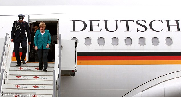 Investigation: German Chancellor Angela Merkel disembarks from one of the two German government planes