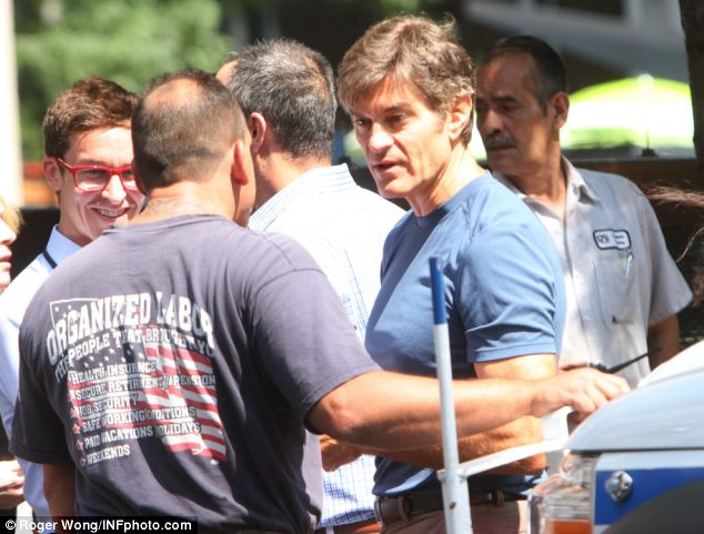 Emergency: TV personality Dr. Mehmet Oz, pictured, was near and rushed to the scene to help victims