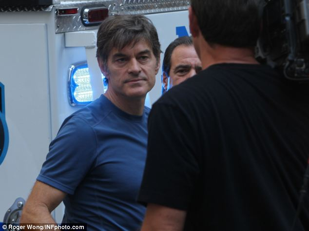 Acting on impulse: Dr Oz rushed from his office which is just across the street as the scene unfolded