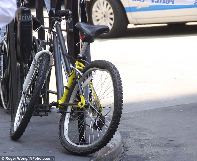 Damaged: A cyclist was thrown from his bike and over the hood of the taxi as it lost control on Tuesday