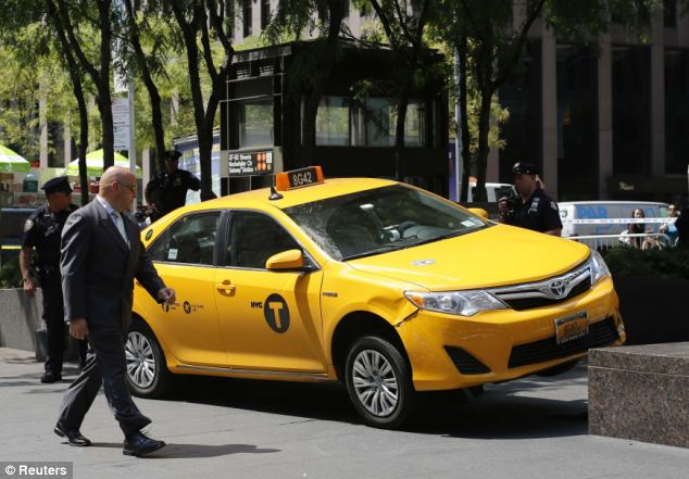 Crash scene: A runaway taxi came to a stop on the curb in Midtown, New York after swerving to avoid a cyclist and plowing into pedestrians. A British tourist suffered a severed foot in the crash