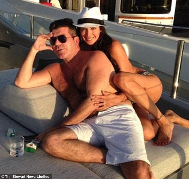 In love: Simon Cowell and Lauren Silverman on board the Slipstream yacht in St Barths in January. She captioned the picture 'Me and my lil Simey monster #simoncowell x'