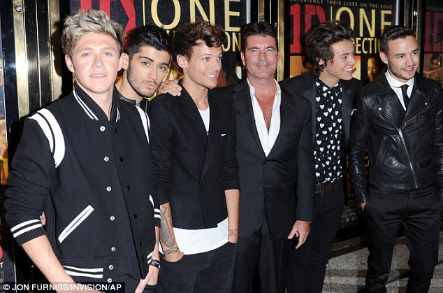 Grinning: Simon Cowell was delighted to join One Direction - the boyband he formed on X Factor - at the premiere of their movie in London tonight