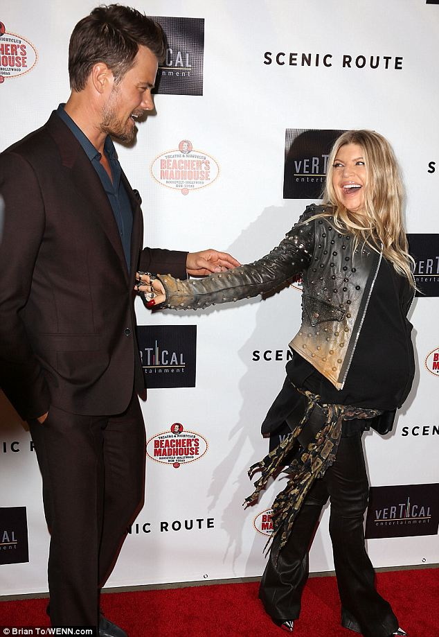 Happy together: Fergie and Josh shared a joke on the red carpet