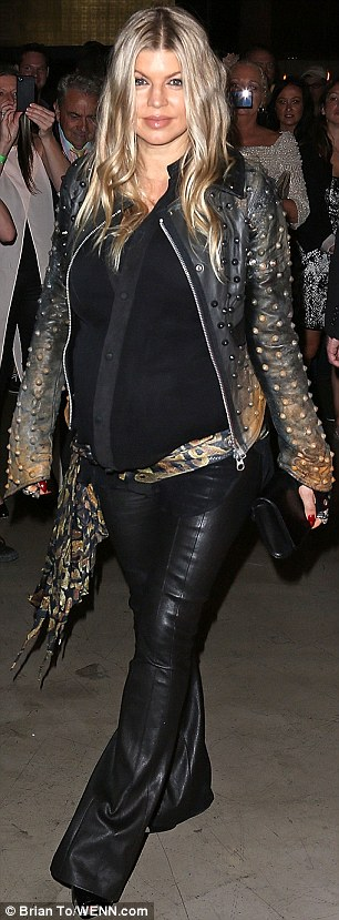 Keeping her edge on: Fergie teamed her outfit with a snakeskin print sash and spiky silver heels