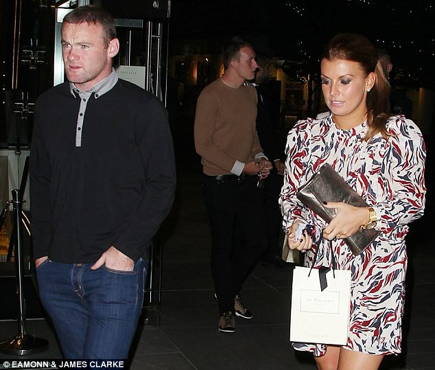 Testing time: Wantaway Wayne Rooney at a United team dinner on Tuesday
