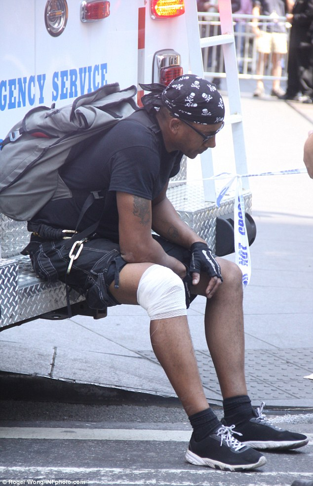 The 40-year-old cyclist, whom the taxi had swerved to avoid hitting, would not give his name. He suffered minor injuries and his knee was bandaged at the scene