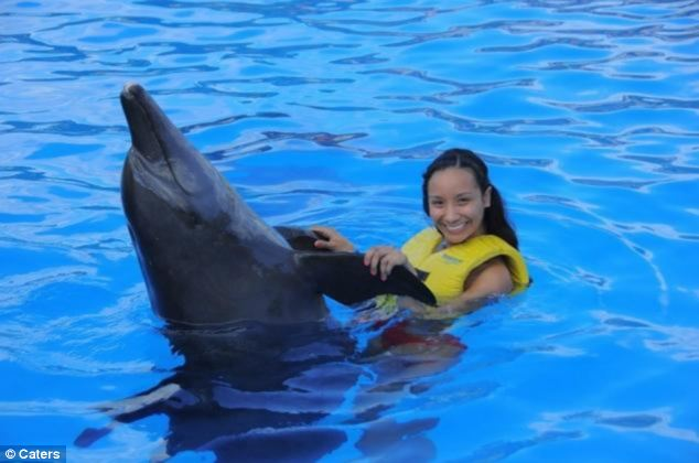 Sian Green poses with a dolphin during a recent