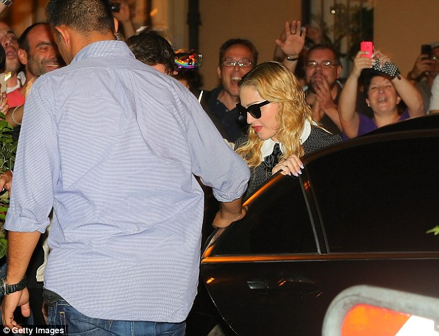 Here I go! Madonna is mobbed by fans as she leaves her limo