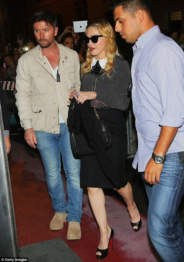 Trend-setter: Madonna wore this stylish outfit when she visited her Hard Candy Fitness in Rome, Italy on Tuesday