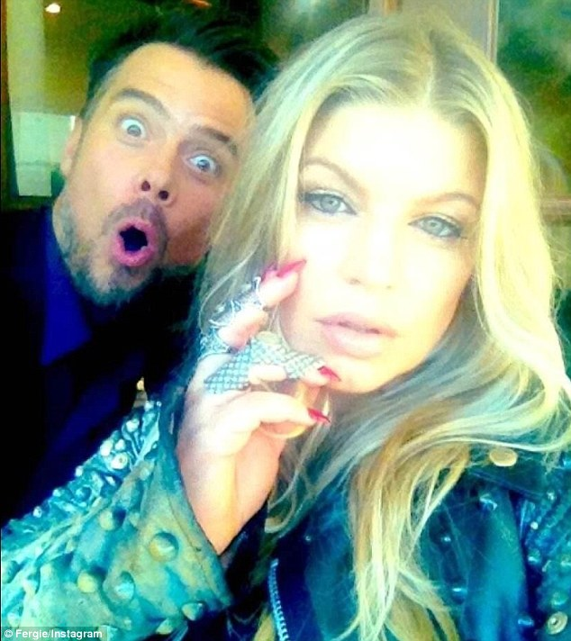 Random photobomber: Fergie posted a self portrait entitled 'Rocker Mommy' which showcased the finer details of her ensemble