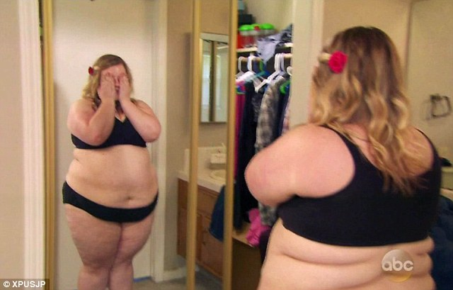 Ashley reacts to seeing herself in the mirror at the start of the weight loss journey