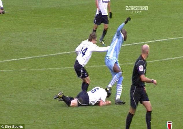 Ouch: The Italian striker stamps on Scott Parker