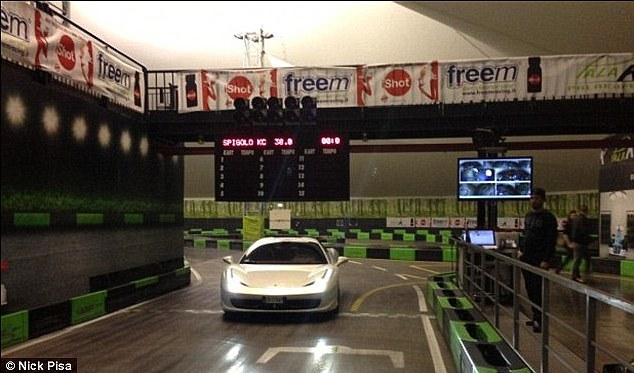 No problems: Balotelli takes his Ferrari for a spin around a go-kart track