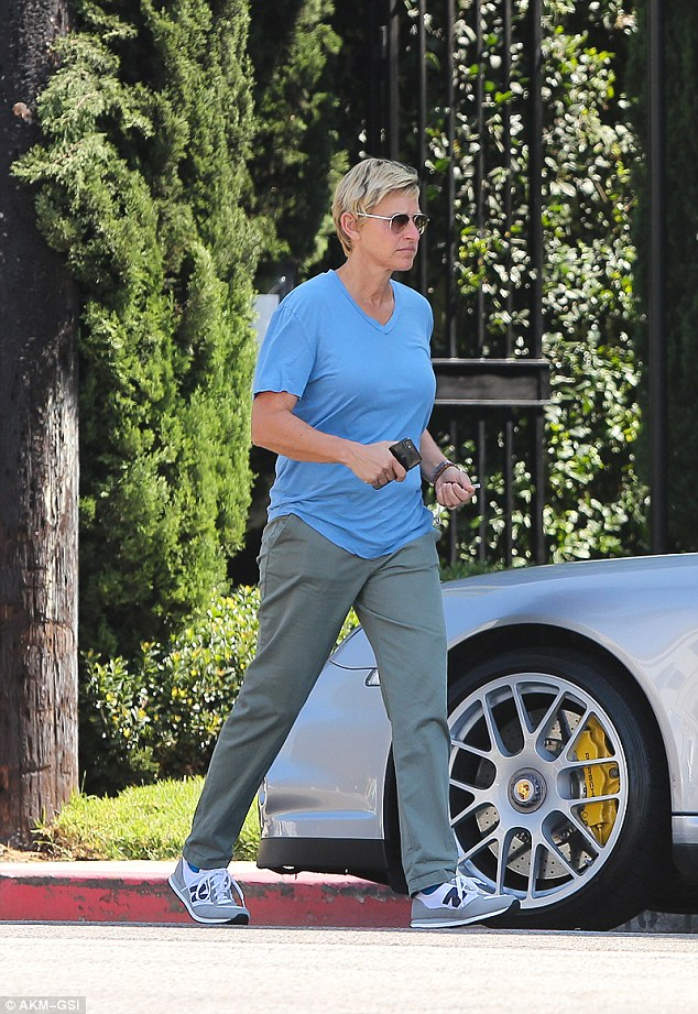 What, this old banger? Ellen looks nonchalant around her car in a town where sports cars are a common sight