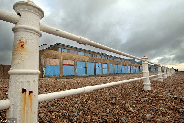 Derelict: The once popular beach huts of St Leonards in Hastings are now boarded up and abandoned