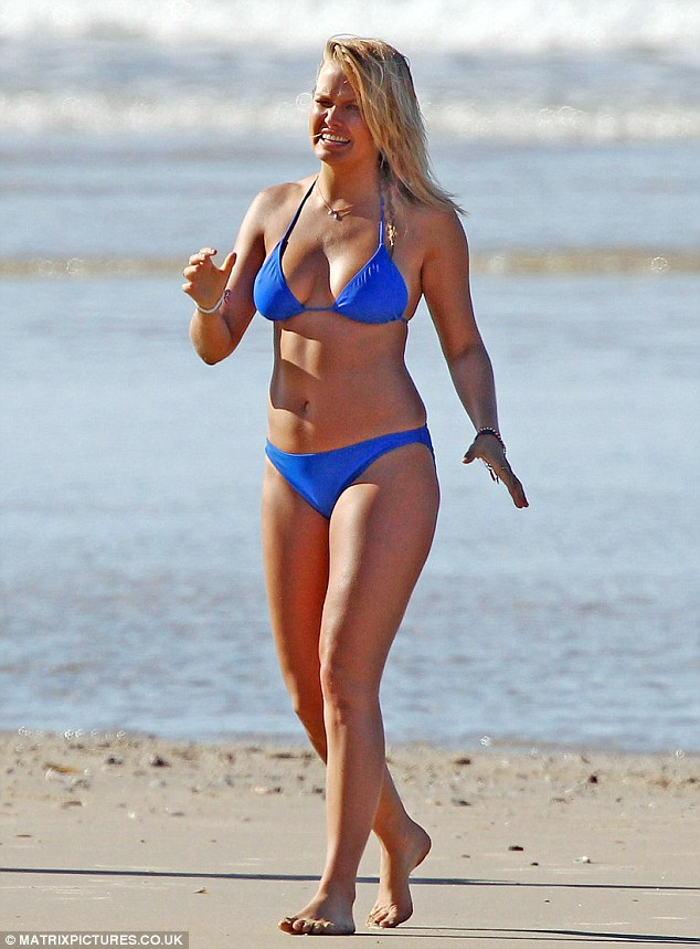 True blue: Lara's curves were on full display in the skimpy selection of swimwear