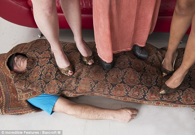 I'm the human carpet: Georgio T., 52, has been rolling himself up in an array of rugs for the past 15 years and claims that he loves the feeling of being trampled over - especially when it's women in high heels