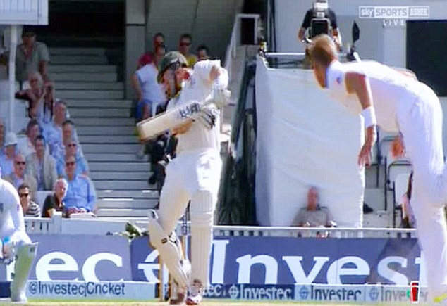 Nasty: Watson is hit on the head by a Stuart Broad bouncer