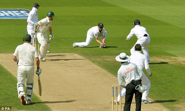 Rogers and out: The Australia opener (second left) is caught by Jonathan Trott (second right) off Graeme Swann (third right)