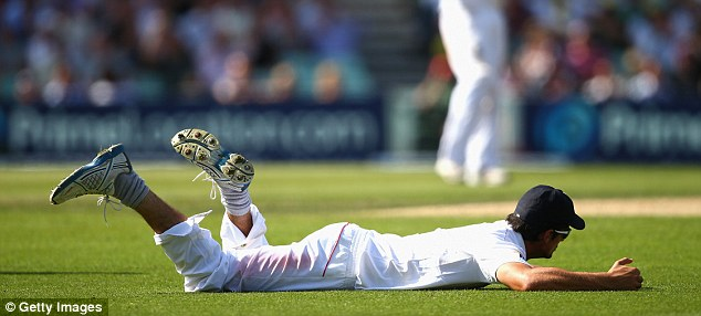 Sinking feeling: Alastair Cook on the ground after dropping Shane Watson on 104