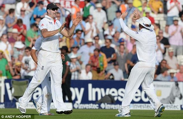 Finally got him: Pietersen (left) is congratulated after his catch