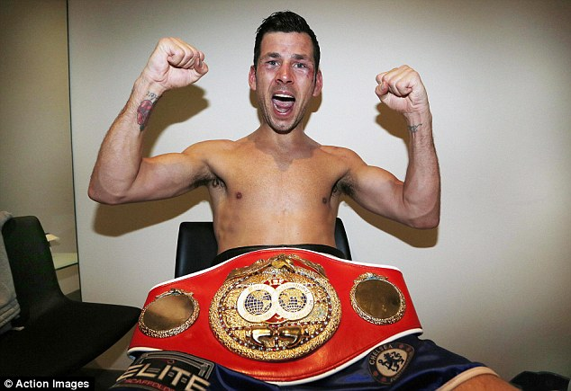 Prized possession: Barker celebrates with his IBF middleweight belt after his victory over Daniel Geale