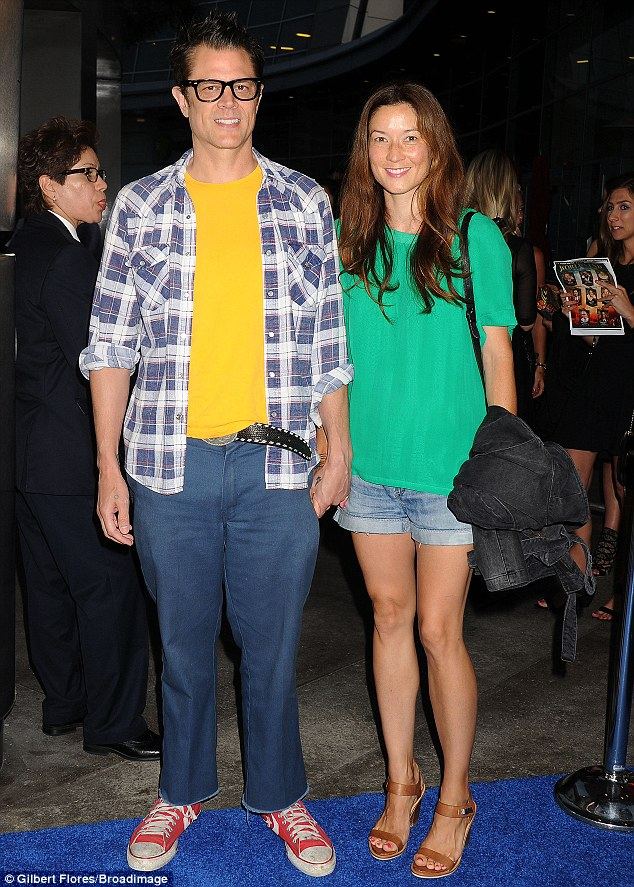 Super casual: Johnny Knoxville, left, and Naomi Nelson, right, dressed down in denim