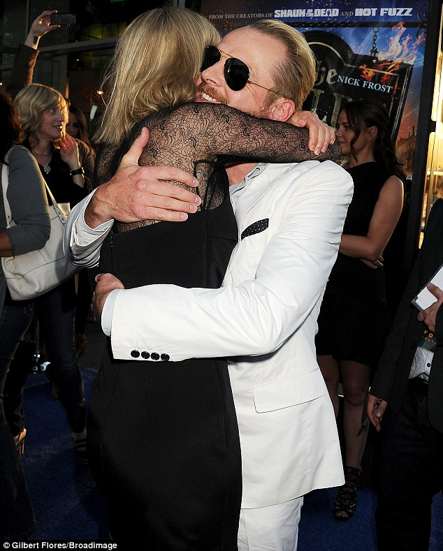 Hug it out! Rosamund and Simon showed their strong bond as they embraced on the carpet
