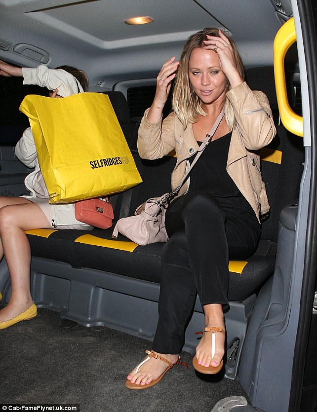 A quick touch-up: Kimberley fixes her hair in the taxi and enjoyed her night out with her friend watching the play