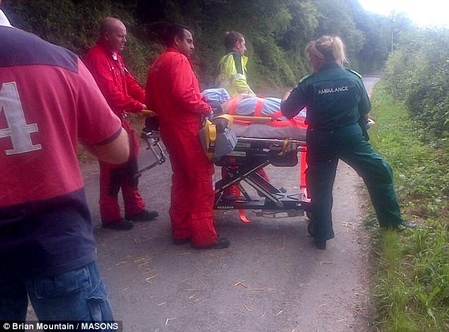 Air ambulance crews prepare the horse rider for her flight to hospital after the animal was spooked by loud firing  - believed to be from French Poachers