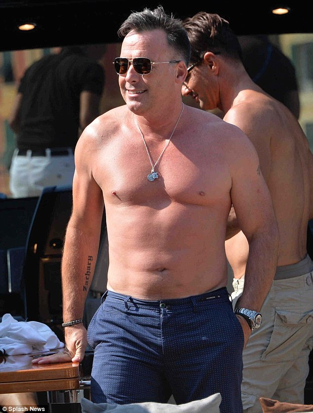 David Furnish, 50, shows off a muscular physique during a recent trip to Portofino in Italy with pals