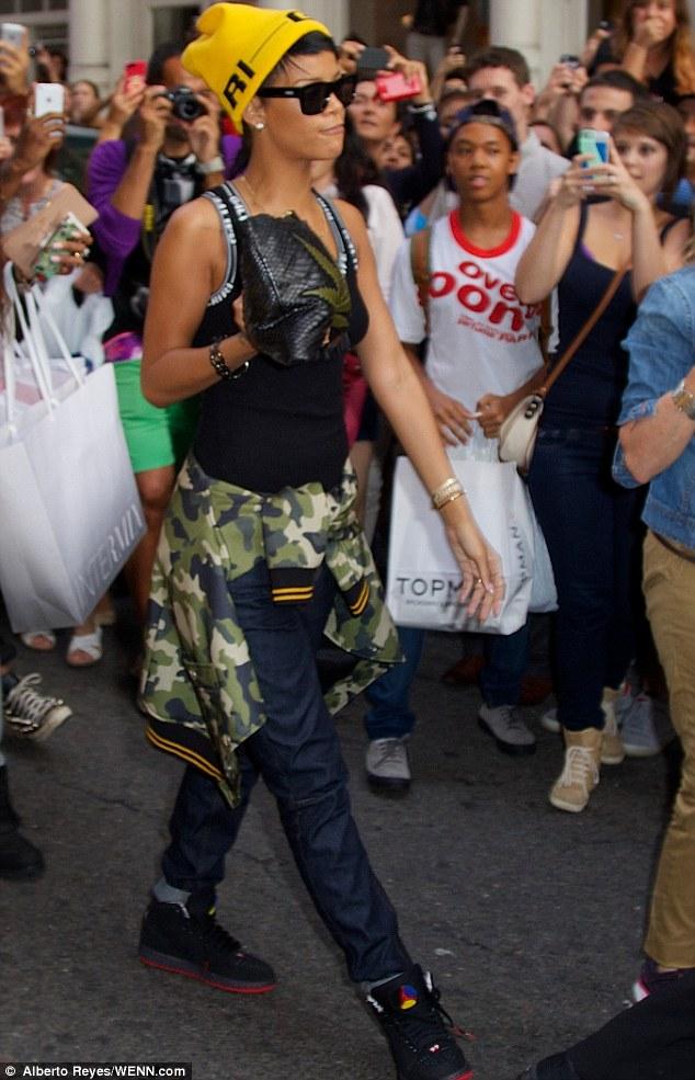 She's got it: Rihanna walks the city's sidewalks as if they were a runway
