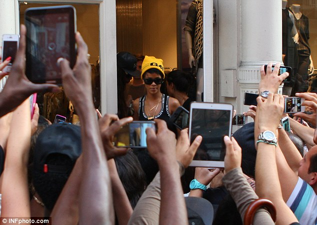 Fishbowl life: Rihanna had her every move documented by her fans desperate to catch a glimpse of the star shopping