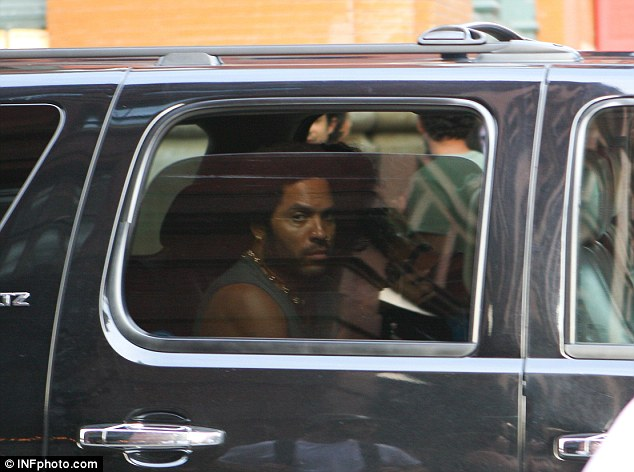 Fancy seeing you here! Lenny Kravitz couldn't help but also stare in awe at the Barbadian beauty as he drove past the shop where Rihanna entered with a pal