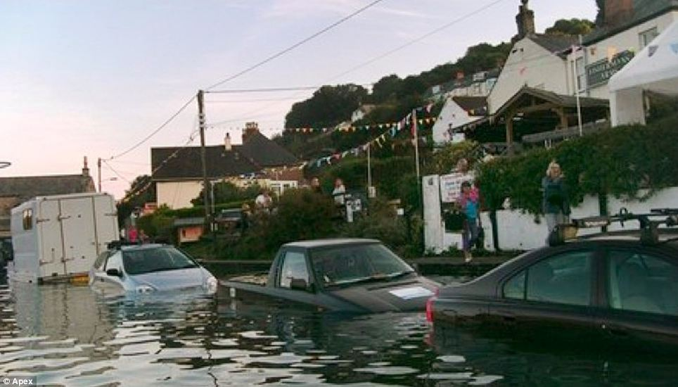 Cars are left flooded after huge spring tides in Golant, Cornwall. These cars were left submerged in water as the spring tides worked to full effect