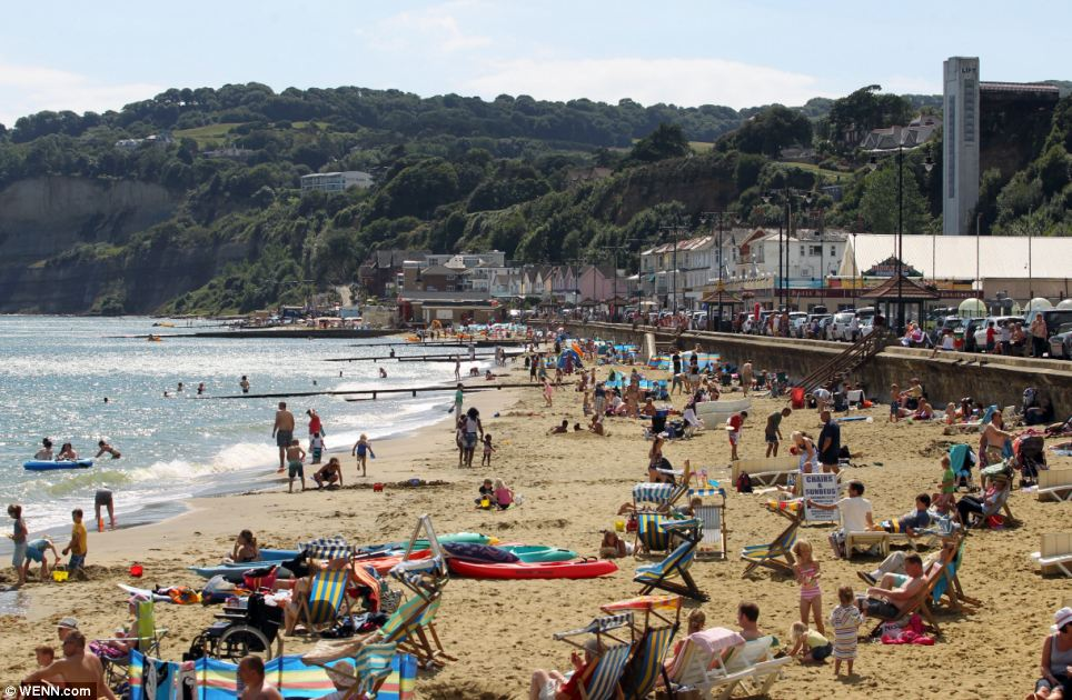Bathers, sun-worshippers and school children enjoyed the return of the warm weather on Shanklin beach in the Isle of Wight