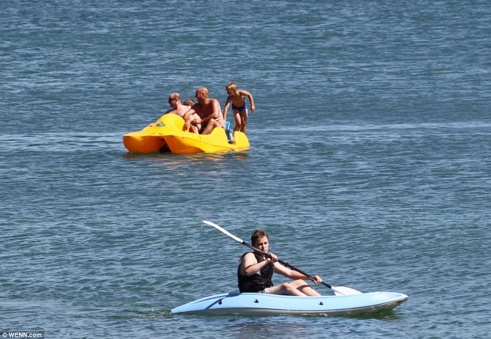 Taking to the sea: People enjoyed a cool dip on the Isle of Wight, canoeing and paddling on pedalo