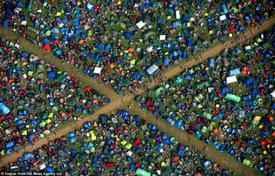 Camping community: Tents have already been pitched at Reading Festival, as people begin enjoying themselves