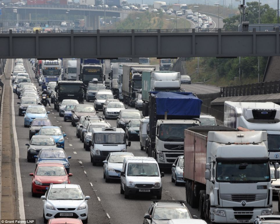 Bank holiday traffic queuing on the M25 towards the Dartford Bridge and Tolls before junction 1a from Kent to Essex anti- clockwise