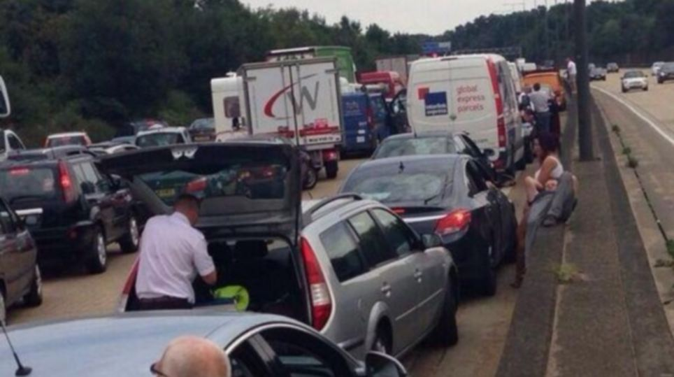 A caravan fire is causing chaos on the anti-clockwise M25, prompting frustrated motorists decided to sit outside their cars rather than wait inside them