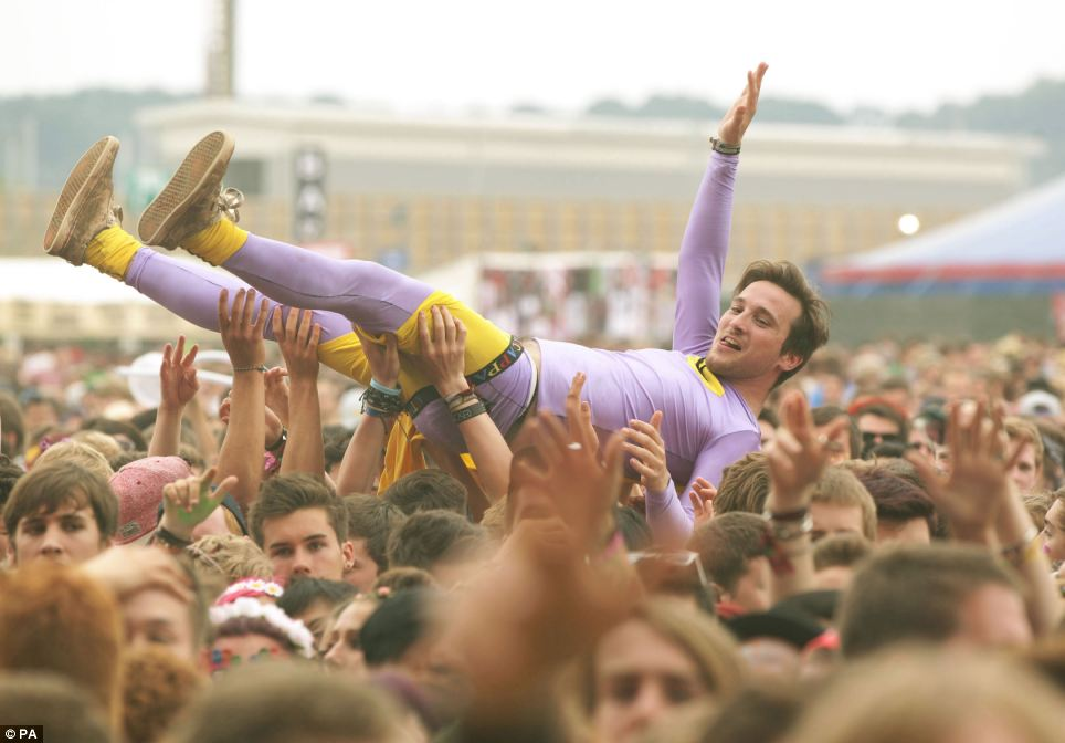 It's off to a wild start:  One man crowdsurfs as the audience watches New Found Glory on the Main Stage, on day one of the Reading Festival