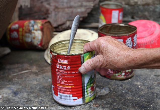 Distant: Food is served in a tin can and passed through the hole in the wall. Hai receives no physical contact despite living just yards from his elderly parents