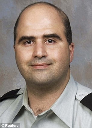 Terror Inspired: This undated file photo provided by the Bell County Sheriff's Department shows Army psychiatrist Maj. Nidal Hasan (left) after his arrest and (right) in his army uniform before he committed his massacre