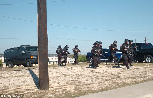 Rapid Response: SWAT team members converge on a building where Army Maj. Nidal Hasan went on a shooting spree November 5, 2009 at Fort Hood, Texas